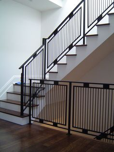 """White walls and black railing. """"www.thesteelworks.ca""""."""