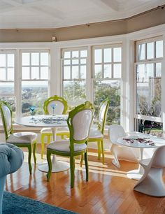 Chartreuse painted chairs, lots of windows, hardwood floors and Saarinen tables.  Dining nook