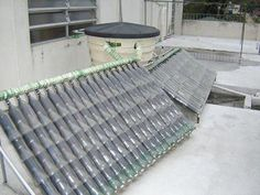 DIY Plastic Bottle Solar Water Heater - Re-use plastic soda bottles and milk cartons to make this solar water heater... #solarpanels,solarenergy,solarpower,solargenerator,solarpanelkits,solarwaterheater,solarshingles,solarcell,solarpowersystem,solarpanelinstallation,solarsolutions,solarenergysystem,solarenergygeneration Buy Solar Panels, Solar Energy Panels, Solar Panels For Home, Solar Power Inverter, Diy Plastic Bottle, Solar Roof Tiles, Solar Water Heater, Solar Projects, Energy Projects