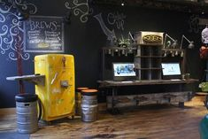 Continuing their commitment to conservation and sustainability, the KEEN Garage in downtown Portland, Oregon reopened after a 10-month renovation of a 105-year-old building that generated less than one dumpster of waste. Downtown Portland, Portland Oregon, Man Store, Garage Renovation, Man Caves, Beer Bar, Chalkboard Paint, Old Building, Fashion Stores