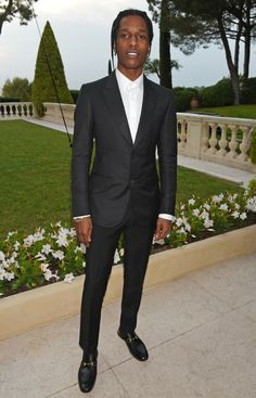 At the amfAR Gala Cannes, A$AP Rocky wore a Gucci DIY Made to Order Heritage tuxedo with a white evening shirt, grosgrain bow tie and Horsebit slippers.