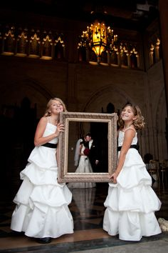 Wedding picture idea with an empty frame. I love this!