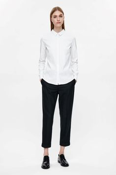A COS favourite, this slim-fit shirt is made from crisp cotton-mix with a slight stretch. A tailored style, it has long sleeves, narrow collar and concealed front buttons.
