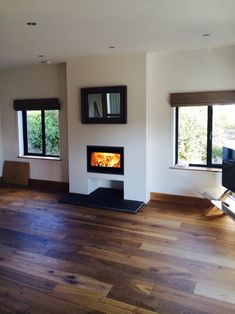 In this newly refurbished room the Scan 1001 fits beautifully. The original fireplace was re-modelled to hold the inset fire and an area was created to house logs. #scan #inset #fire #stove #wood #burner #modern #contemporary #bespoke #log #store #remodel #interior #living #room #lounge #house #home #kernowfires #wadebridge #redruth #cornwall