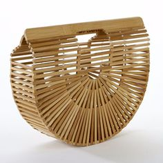 Forget the seasons – right now, all the coolest girls are teaming their wintry edits with wicker bags. And for an update on the woven tote, last year's hottest US export is back for another year, with niche label Cult Gaia's sell-out crescent clutch a return favourite of fashionistas.