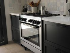 Ikea TORHAMN kitchen spray painted in Farrow & Ball estate eggshell. Ikea Griljera range cooker