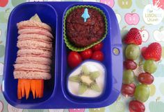 Guy Fawkes (Bonfire night) bento box with rocket sandwich and rocket fruit skewers. Goodbyn lunchbox, rocket food pick and silicone cup all from www.thelunchboxqueen.co.nz