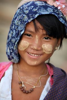 Myanmar (Burma) z and a wear these dots of paste on their faces, too!