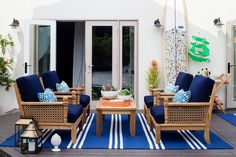 """Orlando diagnosed Gray'slove of color immediately.The goal was for the deck to feel color rich rather than color crazed. """"I'm such a huge fan of indigo,""""Orlando says. """"It can be masculine and feminine, so it felt appropriate in a home where two men live."""