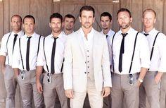 groomsmen wearing suspenders