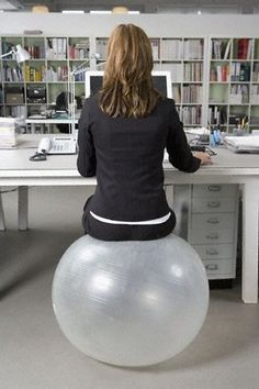 Swap out your regular desk chair for an exercise ball. The ball keeps your core engaged and helps improve your posture at the same time. Desk Workout, Gym Workouts, Office Exercise, Exercise Ball, Office Organization At Work, Core Stability, Ball Chair, Workout For Beginners, Going To The Gym