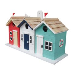 This Beach House Bird House features three side-by-side nest boxes in red, white and aqua. Avian residents will appreciate the unpainted interiors complete with drainage and ventilation.