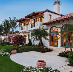 Spanish style exterior with balconies and landscaped terrace