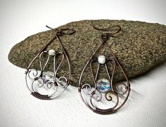 A personal favorite from my Etsy shop https://www.etsy.com/listing/523673686/copper-wire-wrapped-filigree-earrings