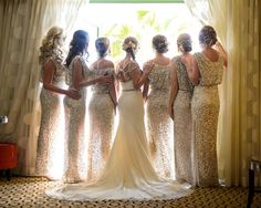 The perfect last dressing room memory, this moment is a metaphorical adieu before your girls send you off to your groom. Looking out the window symbolizes looking to the future ahead —or it can just be a way to spy on guests as they arrive.Related:All That Glitters: Metallic Wedding Inspiration