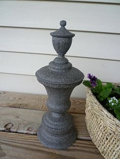 "old lamp, jp weld + stone-texture paint = ""stone"" garden sculpture    could also fill glass vases with quikcrete... make birdbath base..."