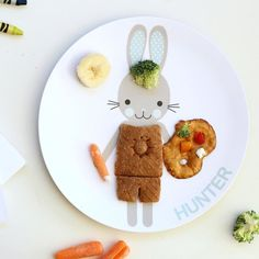At @munchkins_and_moms we  arts and crafts! It's only natural that our bunny would join our fun with a pretzel palette of yummy food . Did you know @dylbug_ also offers cute little notepads that kids can color and decorate? Try letting your munchkins start a food journal and coloring pictures of their #HopHopDressUp plates each day! by dylbug_