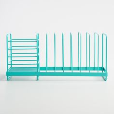 Perfect for small space kitchens and college dorms, our exclusive aqua dish drainer makes the most of its compact size with room for full-sized plates and a basket for utensils.