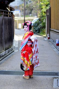 Young Japanese girl dressed as Geisha Maiko near a temple in Kyoto. #kyoto #maiko #geisha #japanese #girl