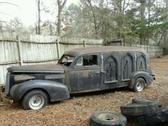 Really creepy vintage hearse. I don't think I'd ever want a hearse, only planning on riding in one once!
