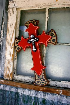 Leopard Red and Zebra Stacked Cross... i'm sorry, but this looks like something tommy lee would put up to accompany the leather cowboy hats on the wall