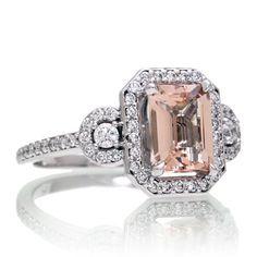 Emerald cut morganite engagement ring diamond halo three stone band