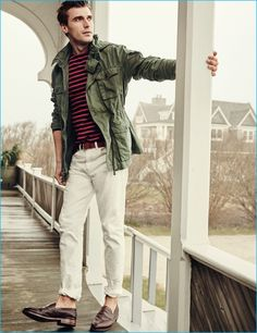 Clément Chabernaud channels a military ease in J.Crew's mechanic field jacket, white 770 jeans, Ludlow penny loafers and Saint James for J.Crew unisex Meridien II nautical t-shirt.