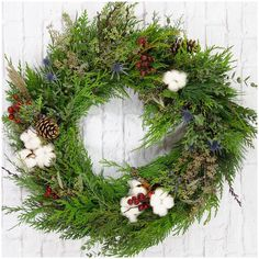 fabulous vancouver florist Custom holiday #wreath available for pick-up and delivery!! Check out our online store or give us a call! #cedar #cotton #pine #christmas by @gardenpartyflowers  #vancouverflorist #vancouverflorist #vancouverwedding #vancouverweddingdosanddonts