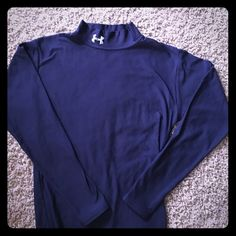Under armour long sleeve Cold weather top! Perfect to layer with. Keeps you super warm. True to size -stretchy. In awesome condition. Navy color. Under Armour Shirts Tees - Long Sleeve