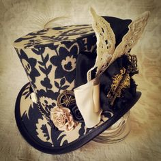 Mad Hatter, Alice in Wonderland, Steampunk Hat, Mini Top Hat, Tea Party, Sherlock, Gothic Hat, Lolita, Cosplay, Women Steampunk Hats, Circus by OohLaLaBoudoir on Etsy https://www.etsy.com/listing/190337343/mad-hatter-alice-in-wonderland-steampunk