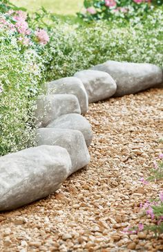 Like Mother Nature crafted it herself, our Faux Roche Lawn Edging is hand-cast from crushed stone and dry-stamped to simulate natural limestone. You'll get 14 stones in the set, each with a stake for securing individually into the ground. Use them, end-to-end, to line your flowerbed, or in decorative groupings. Rock Edging, Lawn Edging, Garden Owl, Garden Oasis, Faux Rock, Tall Planters, Crushed Stone, Flower Circle, Grandin Road