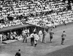Sporting News  July 13, 1934 — New York Yankees' Lou Gehrig is helped off the field in Detroit with back spasms. In the years since, many have speculated that this episode was one of the early symptoms of the disease that eventually felled the Iron Horse. Despite this setback,  the Yankees beat the Tigers 4-2, improving their record to 48-28. Gehrig went on to have a Triple Crown season, batting .363 with 49 homers and 165 RBIs. (AP Photo)