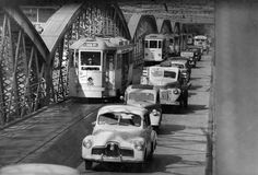 Cars and trams travelling along Victoria Bridge, Brisbane, 1952 Brisbane Cbd, Brisbane Queensland, Brisbane Australia, Old Photos, Vintage Photos, Holden Australia, Brisbane Gold Coast, New Farm, Australian Models