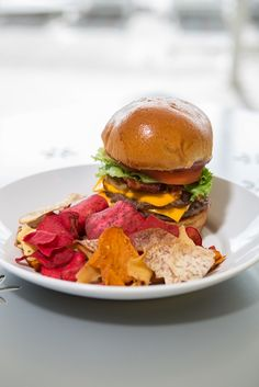 Westin Burger with Root Vegetable Chips at Waves Bar & Grill. Photo Credit: Robert Madrid