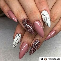 Marble and mauve stiletto nails.