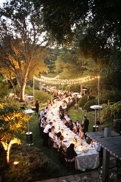 love the one long table idea with lights above it