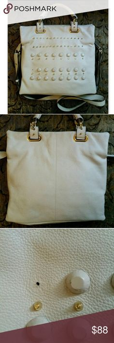 Vince Camuto Handbag Belfast Studded Tote 100% Authentic Vince Camuto handbag!  Edgy chic Belfast large tote in ivory white leather with all over stud detail.  Very good overall condition with some cosmetic wear - one stud missing, some light marks, very small hole in lining (nothing will be lost, looks easy to repair). Tons of life left! Price reflects condition. Large covered studs and gold tone studs with matching gold hardware. Top zip closure. Multiple ways to carry with double handles…