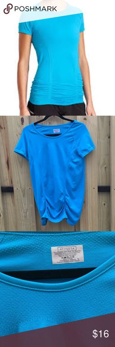 Athleta blue fastest track tee in large EUC Athleta blue / turquoise fastest track tee in perfect condition. Our improved go-to training tee with a new, streamlined fit and our REGUL8 technology so you're never too hot or too cool. INSPIRED FOR: run, gym/training, studio workouts Raglan sleeves give you room to move More streamlined shirring is fit to flatter Gripper dots along hem stop it from riding up #438563 Athleta Tops Tees - Short Sleeve