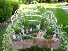 Fairy garden on a lovely wrought iron bench
