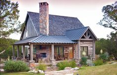 Rustic mountain home. LOVE the fireplace on the porch! Not sure if it is double…