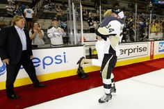 Tom Kuhnhackl's  Mom leaps in to his arms after her son wins the Stanley Cup.