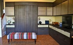 California Closets DFW - Home Office with Murphy Bed and Ecco resins within upper cabinet doors