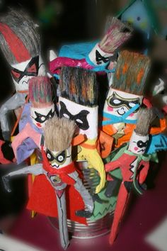 Superheroes using recycled paint brushes