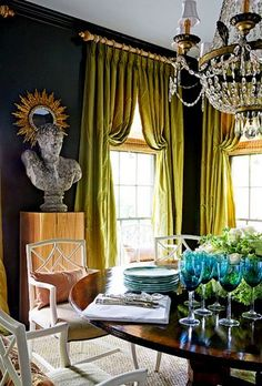Love the curtains. source: R Higgins Interiors Green & blue dining room with dark teal walls paint color, green silk pinch-pleat window panels curtains, gold sunburst mirror, crystal chandelier, round dining table and white lattice chairs. Teal Walls, Dark Walls, White Walls, Decoration Inspiration, Interior Inspiration, Interior Ideas, Color Inspiration, Murs Turquoise, Turquoise Glass