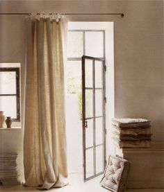 I like the idea of the curtain rod going over both door & window.