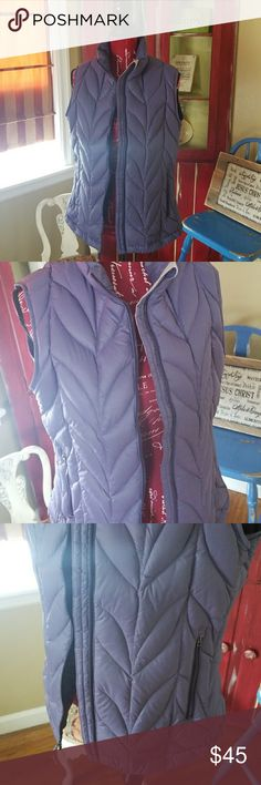 NWOT Eddie Bauer Down Vest! Selling a NWOT Eddie Bauer Down Vest! This vest is super comfortable, deep purple, pocket on inside and two on front, great look and stitching! Size L. Eddie Bauer Jackets & Coats Vests