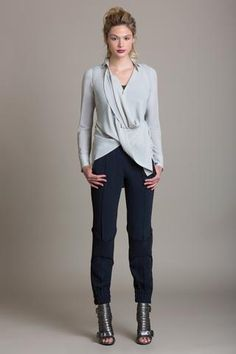 """Product Description  This stretch georgette convertible blouse can be worn at least 5 different ways. Wear it how it looks best on you! Double side back drawstrings Button front Style #: BL3861 Model is 6'0""""  Colors shown: Quinoa Also Pictured:Tailored Drape Tuxedo Pant Size Chart:    US Size Center Back Length Chest Waist   0 29 1/8 42 3/4 53 3/4   2 29 1/2 44 55   4 29 7/8 45 1/4 56 1/4   6 30 1/4 46 1/2 57 1/2   8 30 5/8 4..."""