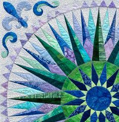 Lois Dunten, Magnificent Metamorphosis. The colors in this quilt begin with a softly toned yellow-green in the center with spring green featured behind the inner compass points. Her colors continue to move through greens, blues, and violets—stopping at red-violet.
