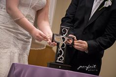 Unity Cross!    We had my Mom bring up my piece and Seth's Mom bring up his piece.  Then we put it together with 3 pegs representing Father, Son, And Holy Spirit are what hold us together.    Hunter Wedding | Lake Charles Louisiana Wedding Photography