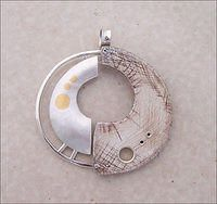 """Lesley McKeown - """"Segregation"""" Sterling silver fabricated hollow form with 24kt gold keumboo and Fuax bone."""